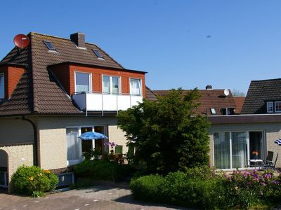 Photo for Apartments only 80 meters from the harbor & the dike in the village Neuharlingersiel