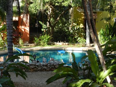 Photo for Charming condo- short walk to town and the beach, swimming pool, a/c, cable