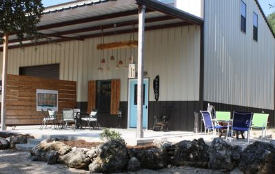 Welome to The Loft at R&R Ranch. Entry door and outdoor seating areas.