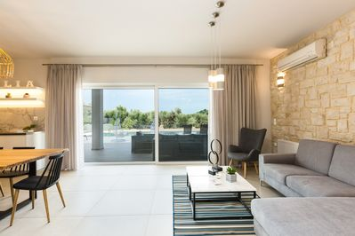 The living area with an easily access to the pool