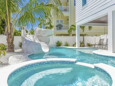 Photo for Beautiful and Spacious 9 bedroom Home, Rooftop Deck, steps to beach, waterslide!
