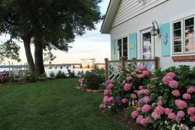 Cottage entry with river in background.