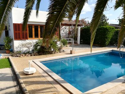 Photo for Holiday house with pool and palm trees