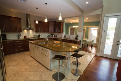 Kitchen area, featuring double sinks and seating for 4