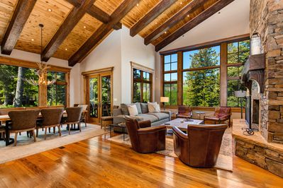 Upper Level Living Room with Fireplace and Deck Access