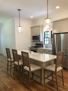 The fully-equipped kitchen with brand new appliances and quartz countertops