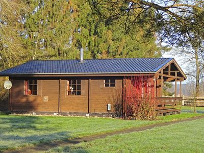 Photo for Detached holiday home in Südheide Nature Park with covered terrace and wood stove