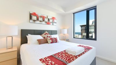 Pillow-top king bed at seaviews StayCentral Serviced Port Melbourne apartment.