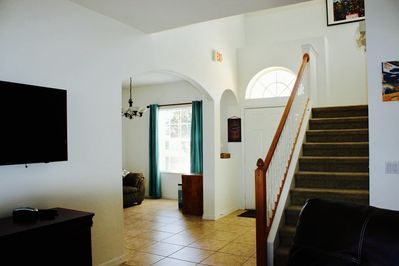 Light, airy & very spacious entrance, hallway & additional seating area.