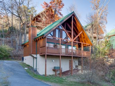 Photo for Refurbished log cabin w/ private hot tub, community pool, & mountain views