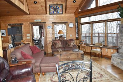 """Great room with comfortable seating, gas log fireplace and 55"""" TV."""