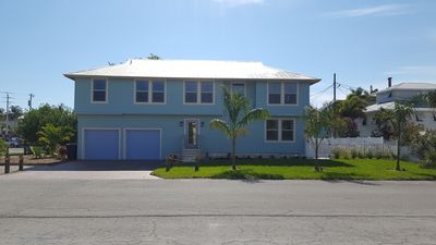 Photo for newly remodeled 4+ bedroom. private pool.  150 steps to beach!