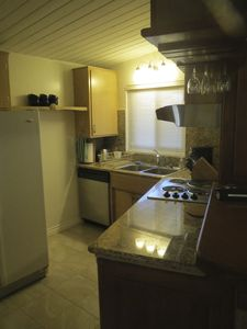 Kitchen also includes full-size fridge with ice maker and water.