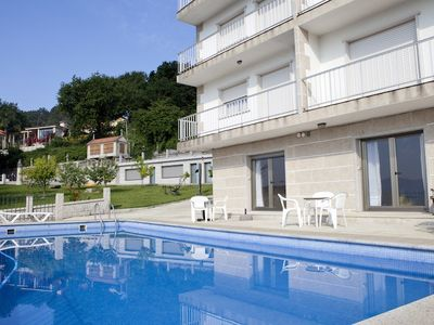 Photo for Pool, garden, playground, tennis court and barbecue. 400 m. the beach
