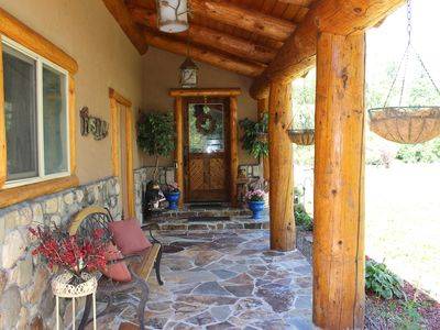 Photo for Riverfront, hot tub, close to Wolf Creek, 4 fireplaces, pets ok, 5 star reviews