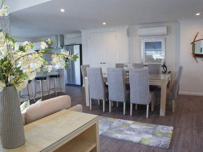 Photo for Stunning nearly new harbour front beach house