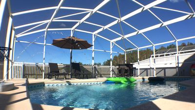 Photo for Disney area, shops & dining. Large home, sleeps 12, heated pool, gated community