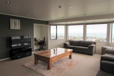 Lounge in the open plan living area with fantastic views of the town and sea