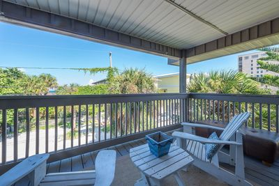 Relax on the oversized patio after a day at the beach