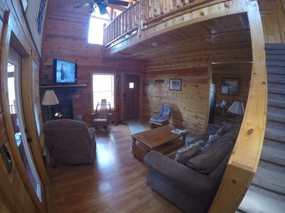 Great room with stackstone fireplace and cathedral ceiling.