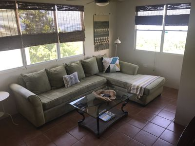 Living room with AC, tv with dish network