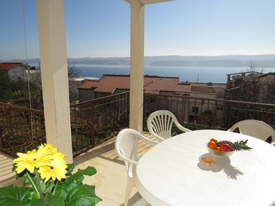 Photo for Two bedroom apartment with balcony and sea view Stanići, Omiš (A-12158-a)