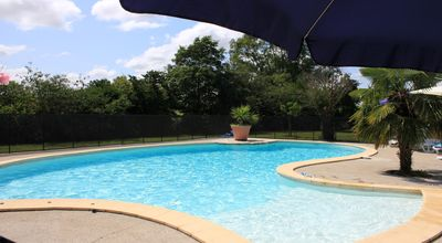 Large heated swimming pool with beach type entrance
