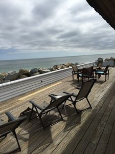 Large front deck runs full length of the house and has plenty of tables & chairs