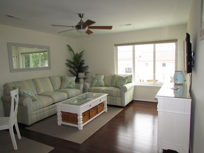 Living Room, ceiling fan, overhead lights, balcony, bamboo floors, smart TV