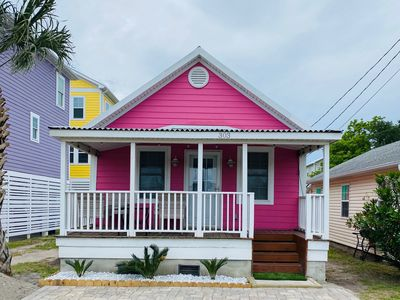 The PINK house with an inviting front porch