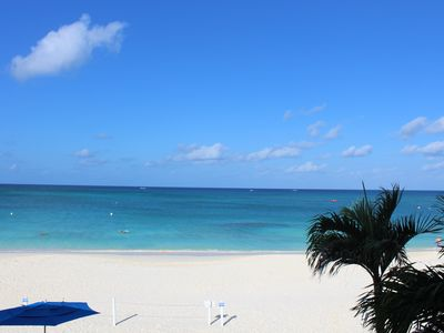 Photo for Luxury Beachfront Oceanfront 3 Bed/3 Bath - Seven Mile Beach - Sunset View