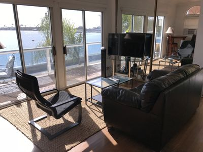 Living room with large sliders to give you an amazing waterfront view