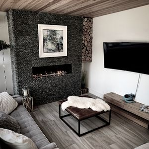 Lounge area with Sky TV & Movies, 2 sofas including one sofa bed, & gas fire.
