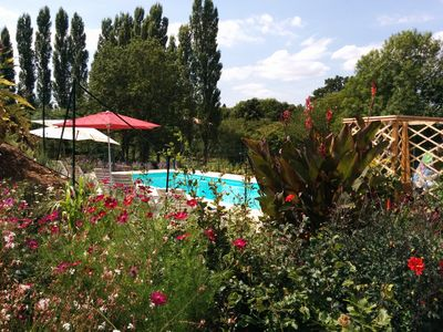 pool from the gardens with the poplar trees which surround the orchard beyond