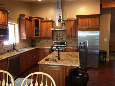 Chef's Kitchen with Dual Oven Stove and Two Sinks