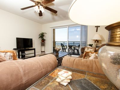 Photo for Pelican Isle 107: Cozy beach front condo, free beach chairs, dolphin cruise