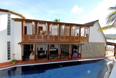 Side view of Beach House and private swimming pool