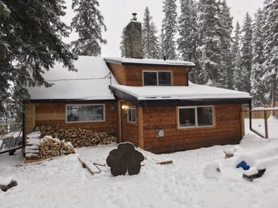 """Photo for Bragg Creek Renovated Historic Log Cabin with River View - """"Papa Bear"""""""