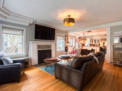 Photo for Steps to beach & park! Charming home w/ a gas fireplace & patios