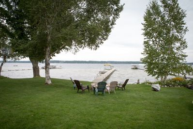 View near the house looking toward a great backyard, the lake and stone firepit
