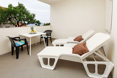 shaded terrace with sea view