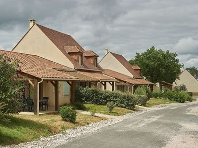 Photo for Villa on a holiday park in the Dordogne with outdoor swimming pool and WiFi