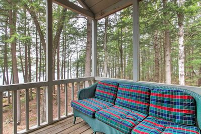 Enjoy your favorite beverage and views of the surrounding birch forest on the fully furnished  screened porch.