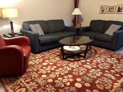 Living room with sleeper sofa, love seat and swivel rocking chair