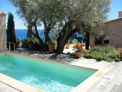 Photo for Charming villa, 180-degree sea view, direct access to the sea, heated pool