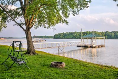 Get ready for the Kentucky vacation of a lifetime at this 4-bedroom vacation rental cabin with private covered dock.