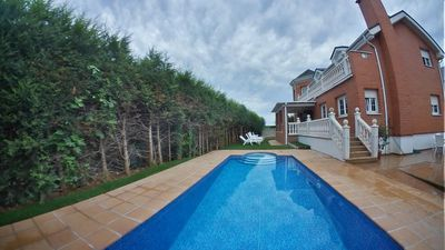Photo for English chalet in Santander with private heated pool