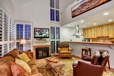 Fireplace, plenty of comfortable seating, HD TV, bar stools, great views