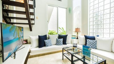 Photo for 2 Bedroom condo with a 2 level high Living Room by BRIC at the Royal Palms