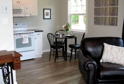 Spacious kitchen area has full size Ceramic Top Stove & Over The Range Microwave